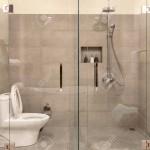 Modern bathroom interior with transparent glass partition.